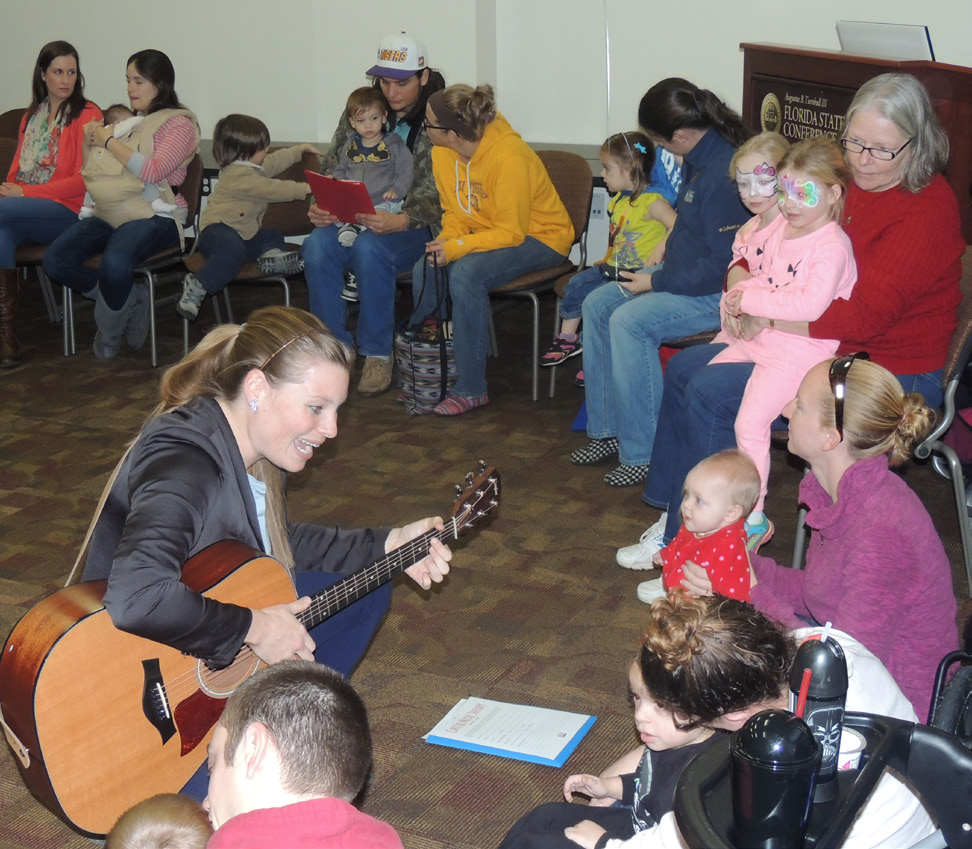 Kids and parents clapped along with the music at the music therapy session.
