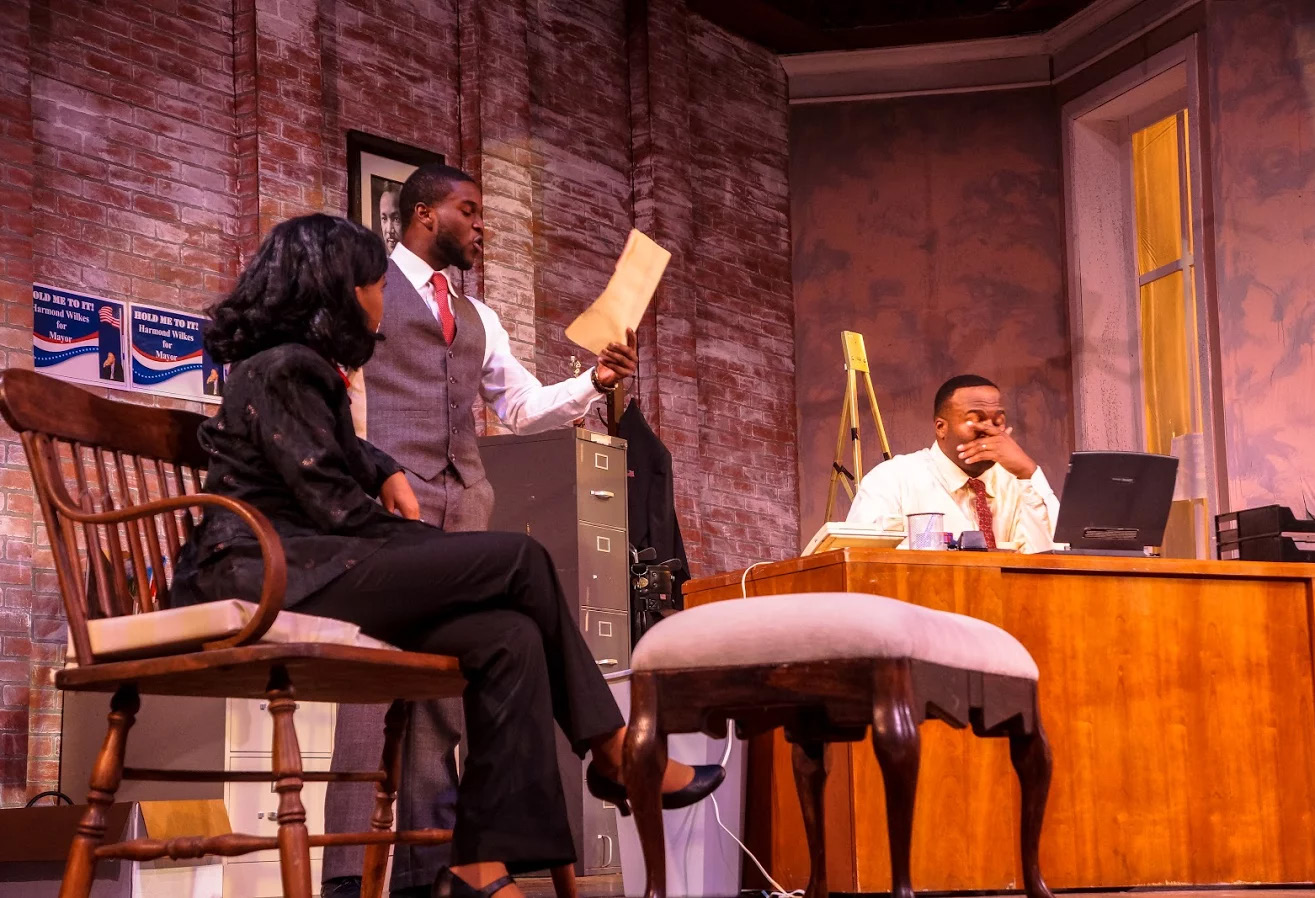Harmond Wilks(Deshaun Green) , Mame Wilks (Yesenia Ozuna) and Roosevelt Hicks (Darren Murphy) discuss the situation the characters have put themselves into.