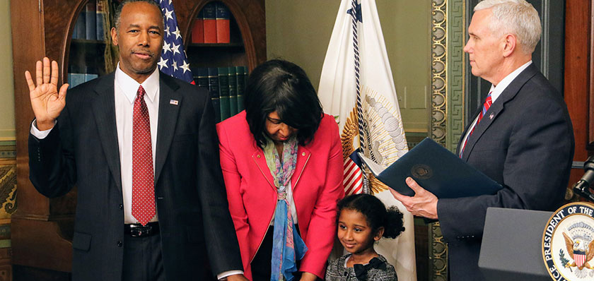 Dr. Ben Carson (left) was sworn in as the Secretary of Housing and Urban Development on Thursday, March 2. Carson's wife along with his 5-year-old granddaughter, Tesora held the Bible.  Photo by Shevry Lassiter/The Washington Informer