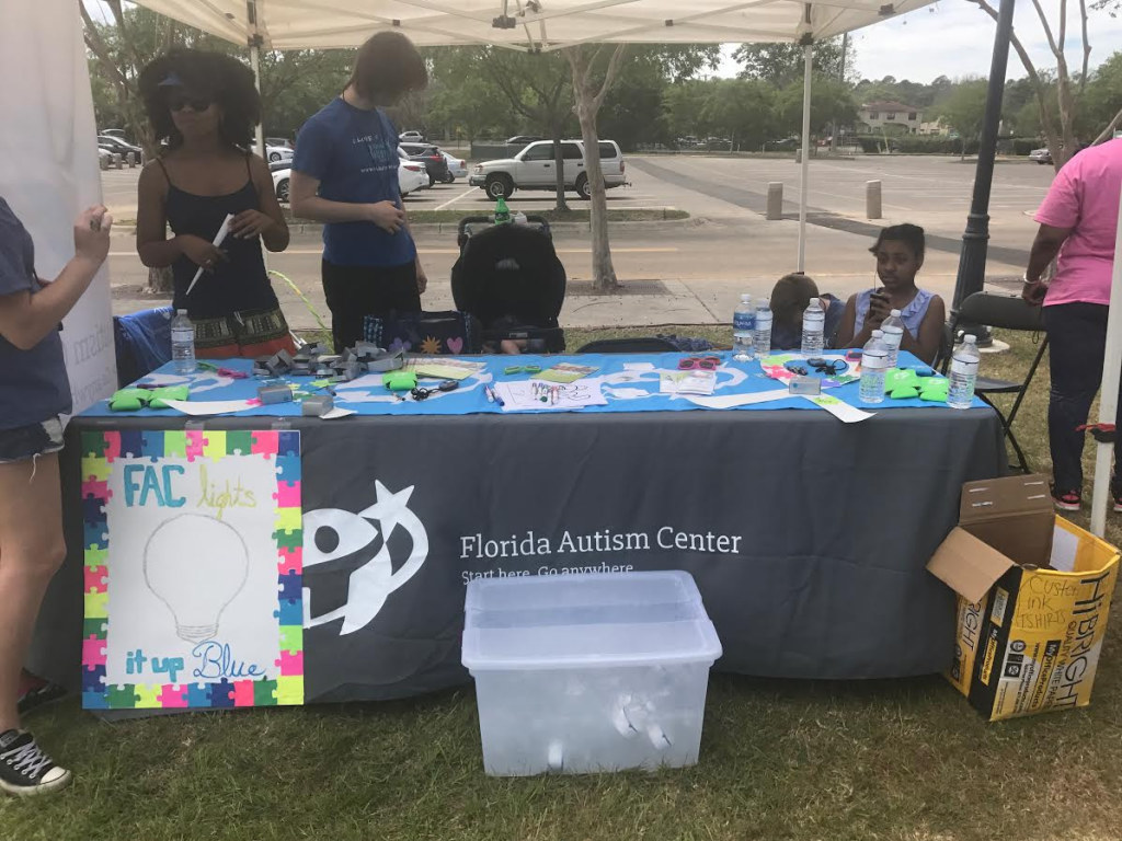 The Florida Autism Center set up a table at the Walk For Autism Event to bring awareness to their institution and answer any questions about the disorder. Photos by Ashia Glover