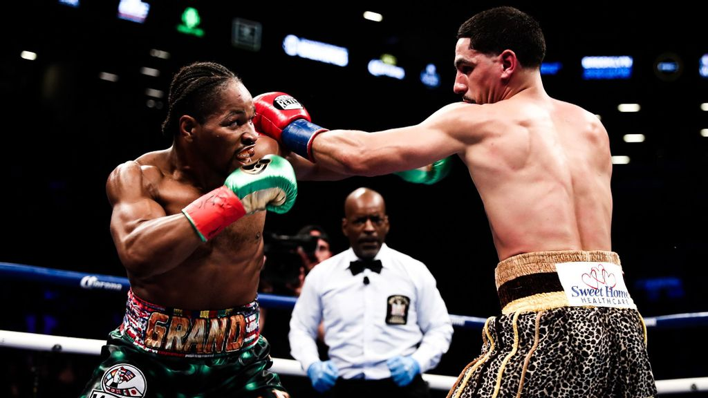 strongShawn Porter (left) overcame an injured left hand to win the WBC's vacant welterweight crown by unanimous decision over two-division champion Danny Garcia in 2018.(Amanda Westcott/SHOWTIME)/strong